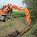 hydraulic attachment ditch clearing draining brush removal tool