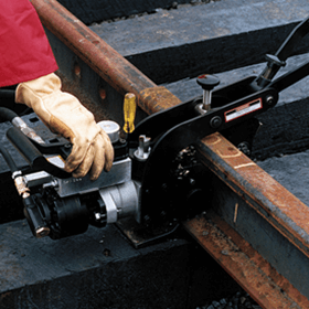 hand on tool on rail hydraulic rail drill in use hydraulic tools and attachments