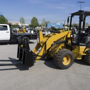 pallet forks front view tractor install skid-steer blue diamond dealer winnipeg