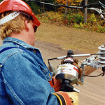 Crimper in use by lineman