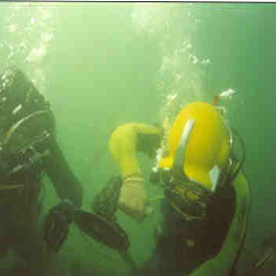 diver operating underwater grinder metal