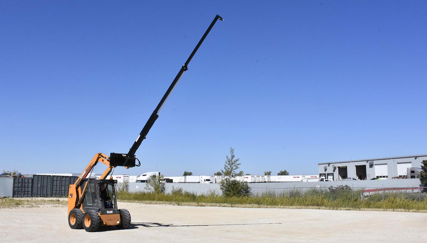teleboom extension attachment for skid steers