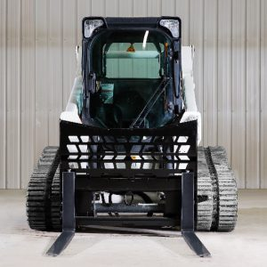 pallet forks attached to a bobcat skid steer